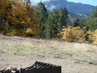 Campfire pit in Table Mountain Campground with Mt Baden Powell in background - Wrightwood CA Camping