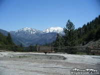 Pine Mountain (left) and Mt Baldy (right) in background of a bench in Vincent Gap parking lot - Wrightwood CA