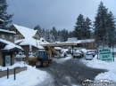 Tractor clearing snow at the Wrightwood Mini Mart. - Wrightwood CA Photos