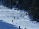 Snowboarders at the bottom of Goldrush at Mt High