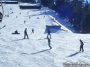 Skiiers and Snowboarders coming down Goldrush toward the top of the East Resort at Mt High. - Wrightwood CA Photos