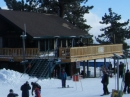 Skiiers and Snowboarders in front of the Grand View Bistro at Mt High East. - Wrightwood CA Photos