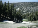 Mounds of snow left where jumps used to be during the winter season on Lower Chisolm run at Mountain High